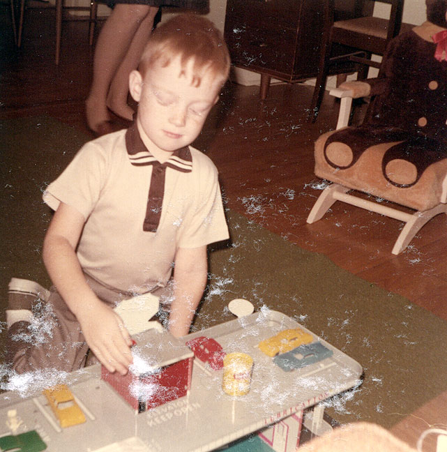 "Your host plays with his toys, c. 1968. Who knew that this kid was headed for a life of sunflower theft? Also of note, the ""bear chair"" in the background was a significant icon of my childhood."