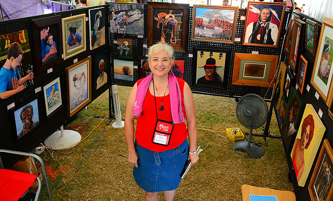 Margaret proudly shows off her work at Arts Festival Oklahoma Sunday.