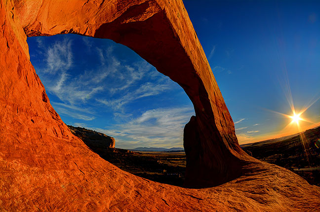 Wilson Arch south of Moab, Utah, soaks up the Sunset.