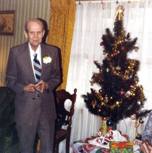 My grandfather Russell Barron poses with a Christmas tree at his home in Independence, Missouri, in 1981.