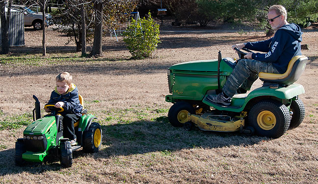"Paul and I drive lawn tractors in a very fun ""just like grandpa"" moment. Paul drove his lawn tractor every day."