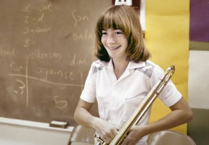 Despite being a drummer, Janet Jones poses for me with a trombone in speech class in ninth grade. My speech was about taking pictures, and in a way was my first teaching experience.