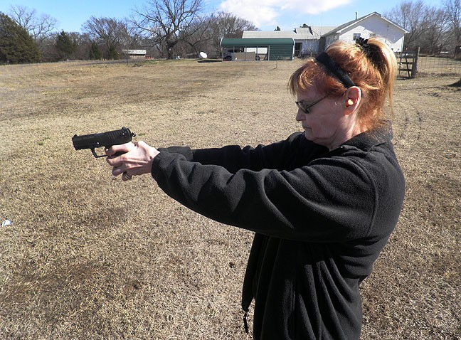 Abby shoots her .380 down at the pond yesterday. We both legally carry firearms, and neither of us care if you are black or white, young or old: if you threaten our lives, we will defend ourselves.