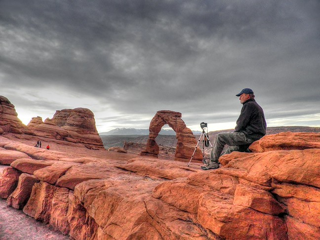 You humble host watches the light change during an early morning visit to Utah's iconic Delicate Arch in October 2014.