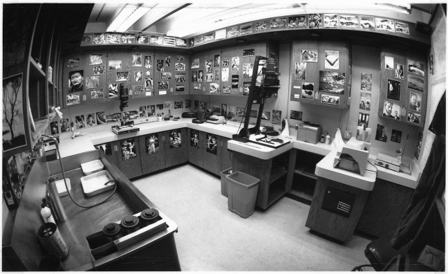This is my office/darkroom sometime in 1994, before any electronic media had entered my photographic lexicon. Note two photographic enlargers, a stainless steel sink with processing trays and chemicals, and an Ektamatic paper processor. (Click it to big it.)
