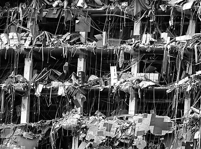 File cabinets, carpeting, office furniture and building material are all visible in the demolished northern facade of the Alfred P. Murrah Federal Building in Oklahoma City April 19, 1995.