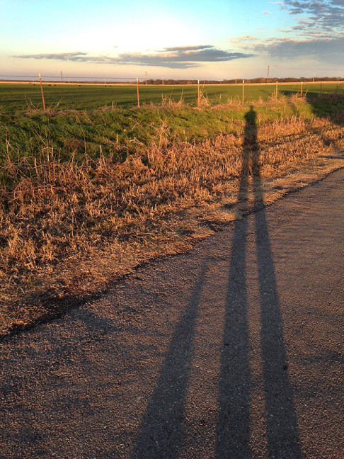 "Max and I cast shadows on the road to Ethel's house, known as ""Upper Road."""