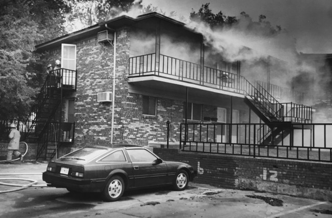 This is the blaze at my apartment complex in September 1995. You can see my parking space, 12, on the right side of the frame. No one was injured, and the building was repaired and reoccupied in a few months.