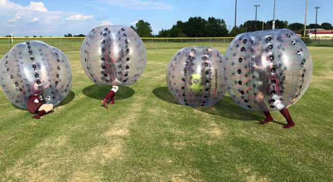 Once the softball girls got inside these things, hilarity ensued.