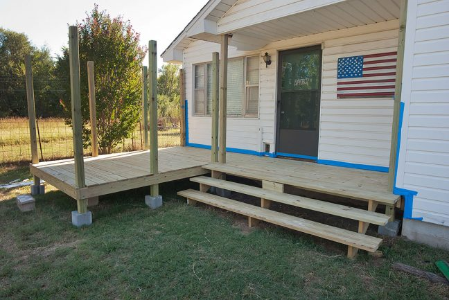 This is the porch and deck at a midpoint in its assembly, prior to being painted.