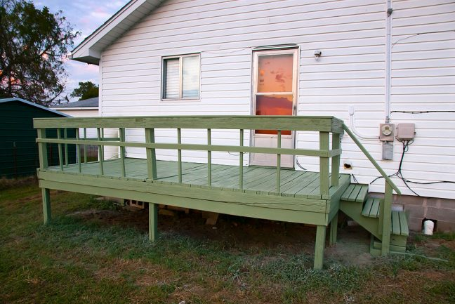 This is the back deck/patio after I completed some major repairs and make some significant aesthetic improvements.