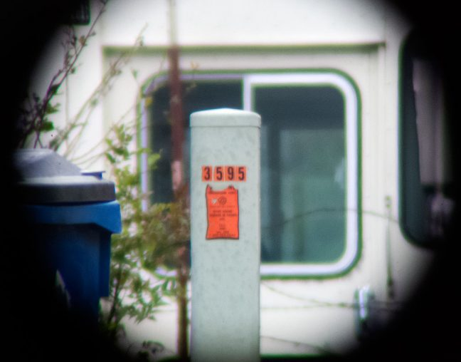... and this is the view through the spotting scope, showing the legible numbers on the electrical box approximately 125 yards away.