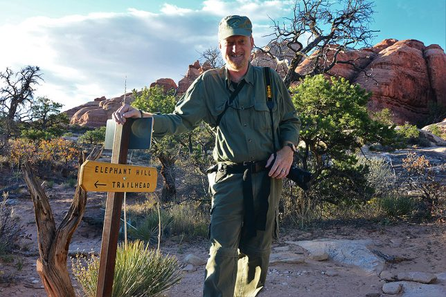 Your host poses at a trail junction deep inside Canyonlands National Park, Utah, in October.