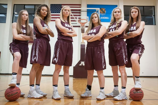 "The Ada Lady Cougar senior basketball players pose for their ""we're tough"" picture at media day. The booster club ended up using this image for a banner they hung at the Cougar Activity Center. From left to right are Kaitlyn ""Katy"" Redman, Madalyn Jessepe, Aleli Thomsen, Bree Willis, McKenzie Dean, and Payton Taylor."