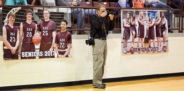 My friend and fellow professional photographer Courtney Morehead shot this image of me recently at the Cougar Activity Center. On either side of me are the pictures I made of the seniors at media day in November which the booster club printed large.
