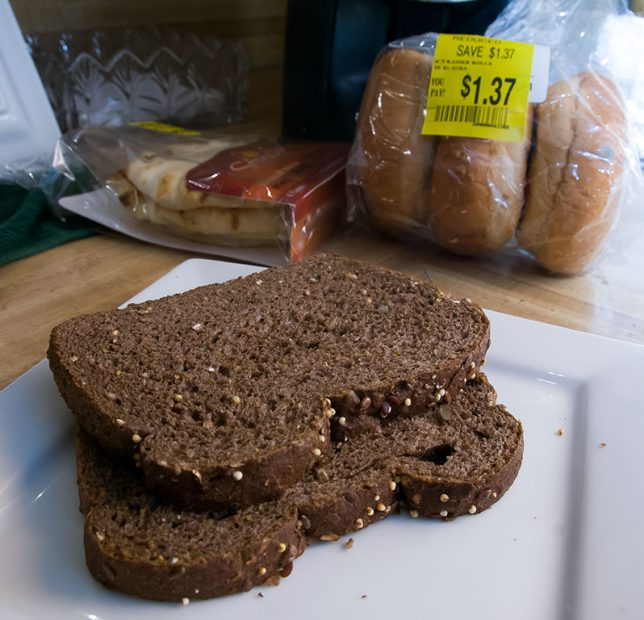 Two slices of Dark German bread sit on a plate in our kitchen.