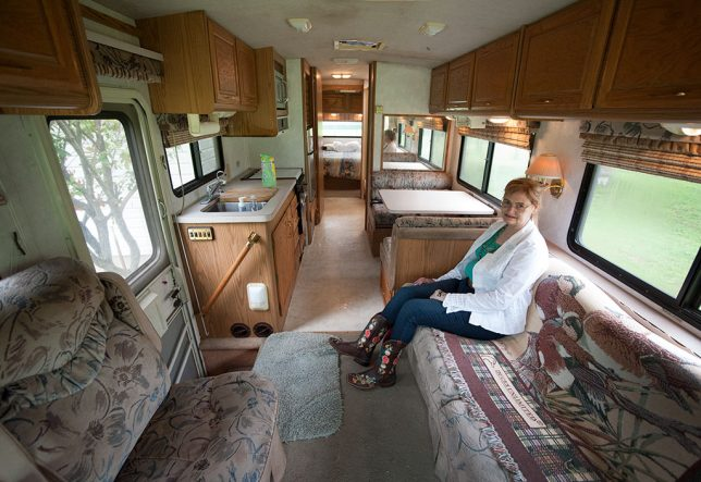 Abby sits on the couch in our RV, The Kokopelli, after cleaning it out prior to selling it to her cousin Donald Ashford.