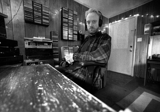 The author sits at his desk in his apartment on E. 12th Street in Ada in the early 1990s.