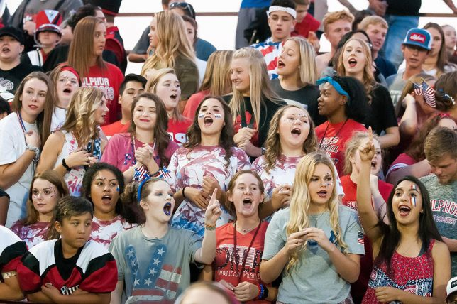 The Sulphur High School student section yells for their Bulldogs football team Friday night as they take on the Davis Wolves in Davis.
