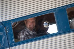Photographer Wes Edens made this image of me peering out one of the huge picture windows of the Ford Tri-Motor.