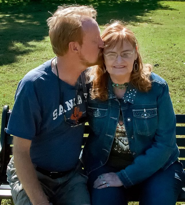 I give my wife Abby a kiss on the head as we pose for photos at her family's reunion in Duncan, Oklahoma Sunday morning. I kiss her in this fashion all the time because her hair smells like sunshine.