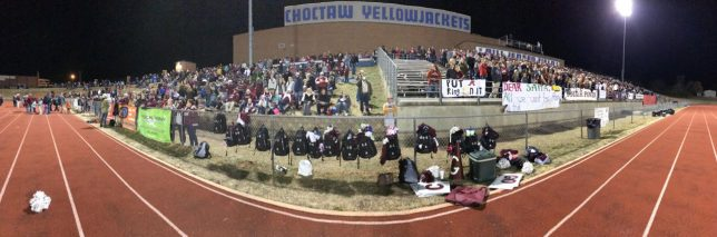 This panographic image shows the Ada High fans at Choctaw High School as their football team takes on Heritage Hall in the Class 4A state championship game Friday night, Dec. 1, 2017 Heritage Hall defeated Ada 14-0 to claim the championship. Despite being stuck on the smaller visitor side, Ada easily sported three times the number of fans as Heritage Hall.