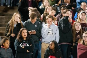 Ada fans look on with dismay in the waning moments of the Ada High vs Heritage Hall Class 4A state championship football game Friday night Choctaw High School. Heritage Hall defeated Ada 14-0 to claim the championship.
