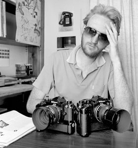 Me in 1985 with the Nikon FM with the 50mm f/1.2 and the FE-2 with the 105mm f/2.5. I know it's the FM on the left side of the frame because it has the soft touch release, which didn't fit the FM-2 of the FE-2. My beard was just a month old, and had never been trimmed.