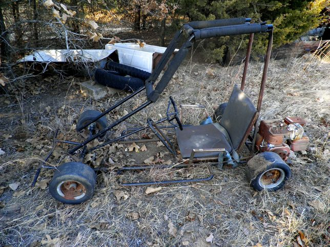 I found this go-kart under a cedar tree on the north end of the patch. The neighbors don't claim it, so I imagine it belonged to Abby's in-laws, the Milligans, decades ago. I have to admit to wanting to fix it and race it.