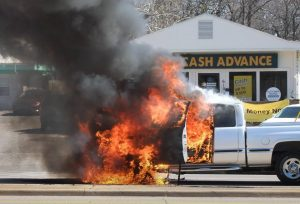 "The most appalling thing about this photo isn't the truck fire. It's the ""Cash Advance"" in the background. It's a microcosm of American idiocy."