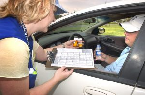 Pittsburg County Health Department Registered Nurse Rosemary King instructs Nick Bailey on the use of medication to treat anthrax exposure during a multi-agency terrorism-related disaster preparedness exercise at the Pontotoc County Health Department Tuesday, Aug. 22, 2006.