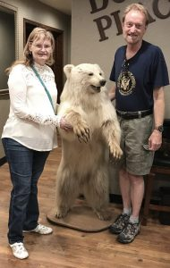 Abby and I pose with the bear at Doc's. The restaurant is so named because it was once Dr. Stout's office when Abby was growing up. The fur was very much like the fur of our Wolfhound Hawken.