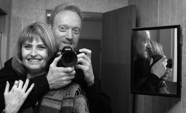 """Abby and I pose in her bathroom mirror just weeks into our relationship. One of the ways I knew I was """"in"""" was that she bought me a tube of Close-Up toothpaste to keep at her house."""