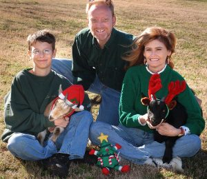 Mitchell, Abby and I pose for a Christmas card with our goats, Coal and Buxton, in December 2004.