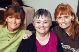 The Shoffner sisters, Gail, Inez, and Abby, pose at Gail's home in Ryan, Oklahoma, at Thanksgiving 2005. Their youngest sister, Gwyn, died suddenly in 2000 when she was just 33.