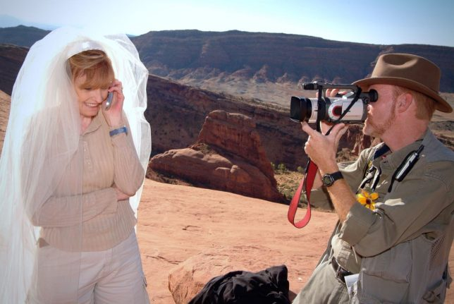 Abby smiles as she talks on the phone with my parents as I make video just minutes after she and I exchanged vows at Utah's iconic Delicate Arch October 12, 2004.