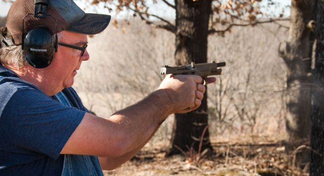 Wes Edens pings a dualing tree with his tan Cerakote .40 Smith and Wesson.