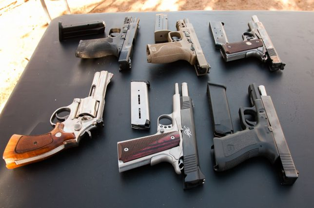 Front row, left to right: Smith and Wesson .357, Kimber 1911, Glock 22. Back row: two Smith and Wesson M&P pistols, and Wes's father's 1911. All were fun to shoot.