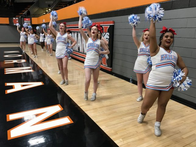 Eisenhower High School cheerleaders yell for their Eagles at the game last night. I haven't been and Eagle in 38 years, and feel far more a part of the local schools we cover here in the Ada Area.