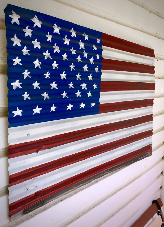 This flag painted on a piece of roof tin was made by a family member of Abby's. We bought it at the reunion's auction.
