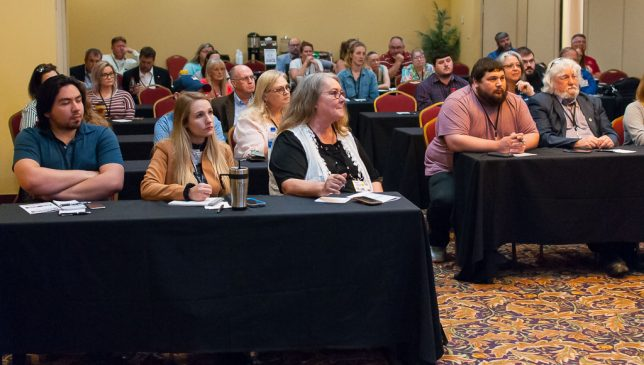 OPA convention attendees listen to a breakout session speaker yesterday afternoon. The young blonde girl on the front row is Ashlynd Elizabeth Huffman, our summer intern.