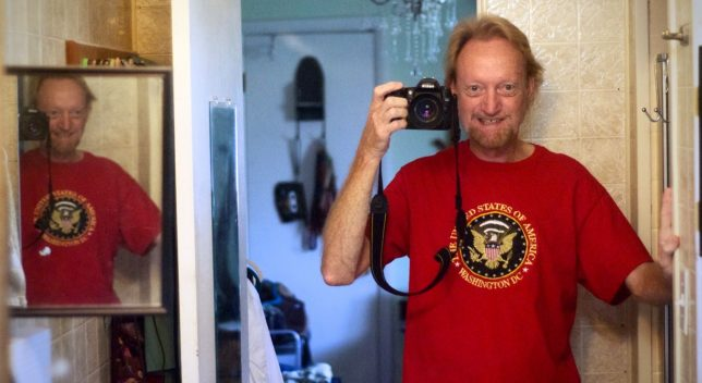 I flopped this mirror shot so you could read the shirt. Abby bought us each a souvenir from a trip to Baltimore and DC years ago, me a blue one and her a red one, but she recently gave me the red one because we both lost some weight and it now fits me.