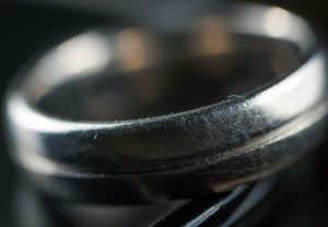 A wedding ring is just a small symbol of the marriage you build, but I happen to love this simple piece of titanium on its own merits: it is cut to be comfortable, it is very lightweight, and I can brag that it's made of the same element as fighter jets.