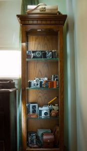 This is the curio cabinet turned into the camera cabinet.