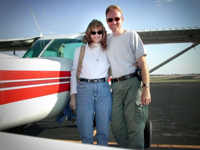 Abby and I pose with a Cessna 152 I was renting in Shawnee in 2003. This was very early in our relationship.