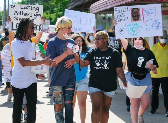 The five young organizers of Ada's Black Lives Matter rally lead the way down Main Street.
