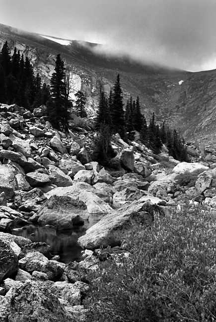 This view from Lincoln Lake looks up the col toward the Mount Evans highway. The white areas near the top are snow.