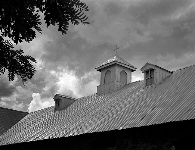 Church Roof and Approaching Thunderstorm, Villanueva, New Mexico.