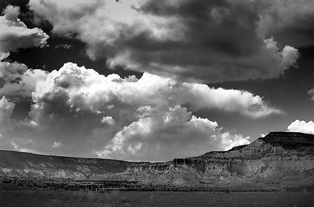 Clouds and cliffs near Ghost Ranch, Chama Valley, New Mexico.