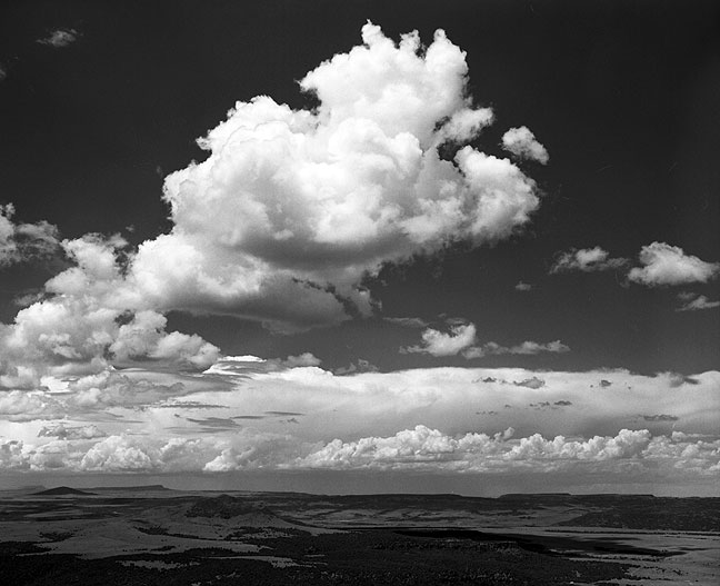 Towering cumulus clouds viewed from the rim of Capulin Volcano, Capulin Volcano National Monument, New Mexico.